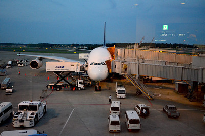 Loading the plane in Singapore. Note the jetways are at two different levels (upper deck rear, main deck forward).