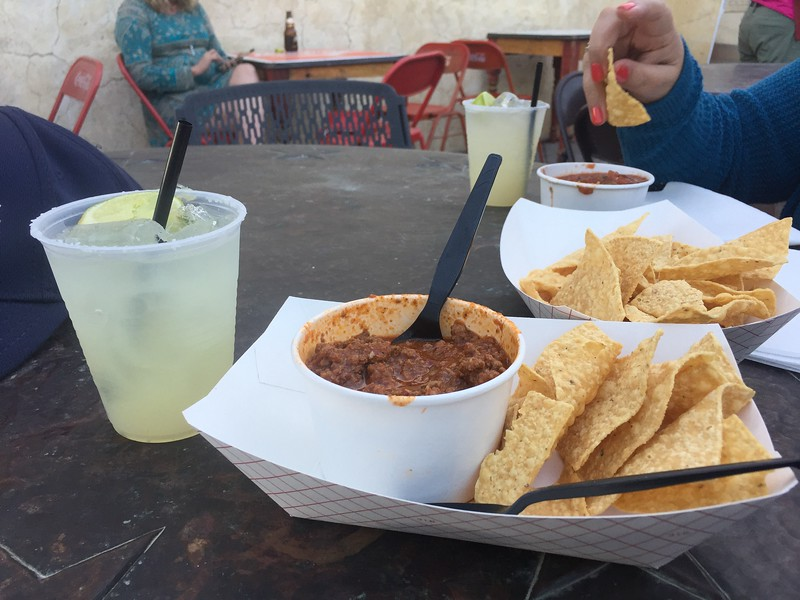 We had to wait for our table, so we hung out in the patio and had some Texas chili, chips and salsa and Margaritas.
