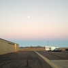 Full moon setting as the sun rises in Ramona.