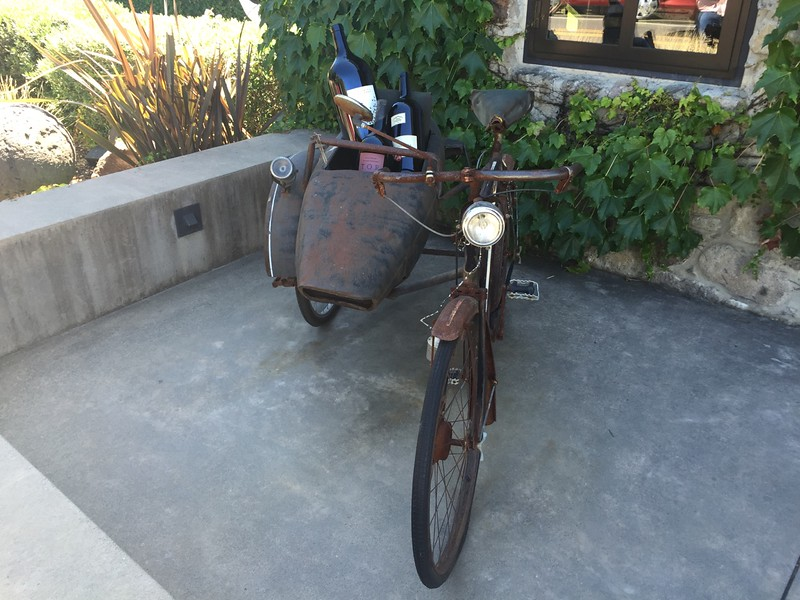 We drove up to Yountville for some lunch. This shop had an old bike with a sidecar full of wine.