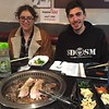 Yum! Alicia and Alex eating Korean BBQ.