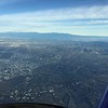 San Gabriel mountains in the distance as we get near Santa Ana John Wayne airport.