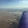 I called up Joshua Approach and got clearance to cut across the Edwards AFB restricted airspace. Edwards Dry Lake (Muroc) is off the wing tip.