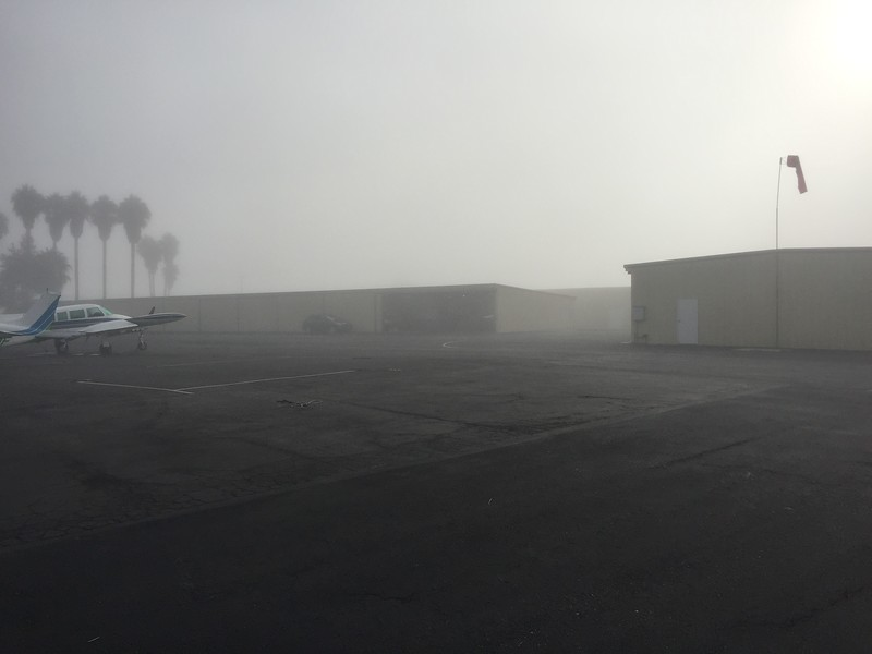I took the scooter around the airport, used the air compressor to top off the car tires and kept an eye out for the fog to lift. I got out of there about 2 hours late!