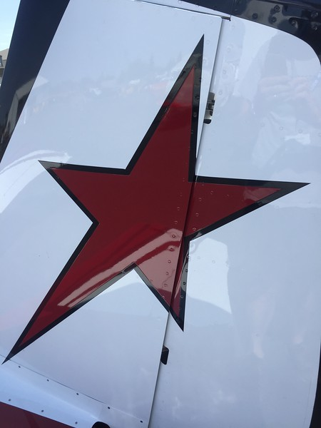 Red star tail art.