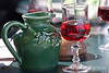 A traditional wine pitcher and glass of rose, patio restaurant, Chateau o Marquayssac, Dordogne, France.