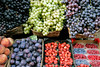 fresh fruit, grapes, peaches, plums, and berries, streetside market, Siena, Tuscany, Italy