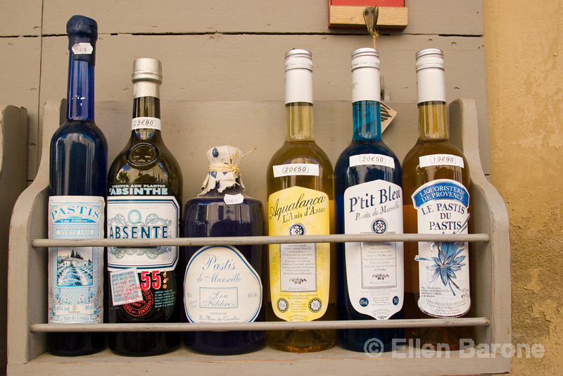 Bottles of pastis, the famous provençal tipple, on display in Lourmarin, Provence, France, Europe