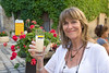 Wayfarers' manager Antonia Hoogewerf enjoys a refreshing glass of pastis in Lourmarin, Provence, France, Europe