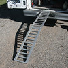 An aluminum fold in half ramp works well for loading and unloading.  This ramp has a 500 Lb capacity.