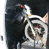 The van holds two bikes easily.  The cargo cage provides a stop for the front wheels.