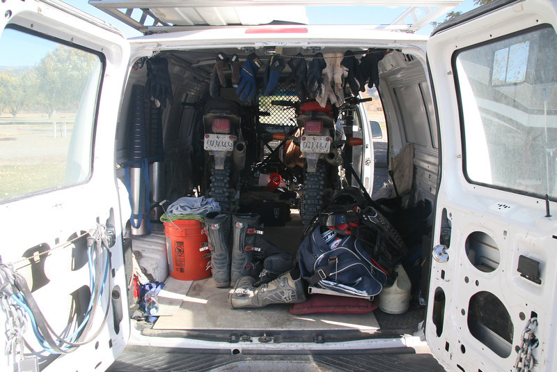 Two bikes can easily fit inside the cargo area.  You can also fit a third bike in between if you back it in.