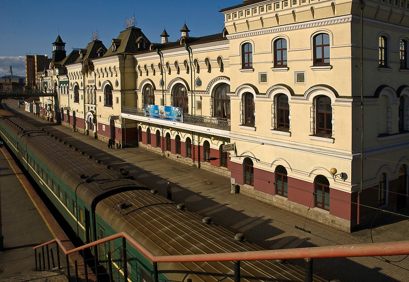 Vladivostok railroad station; terminus of the Trans Siberian Railway begun in 1891, the current route that detours around Manchuria was completed in 1916. The station is styled after the Yaroslavsky Railway Terminal in Moscow which is the western end of the line that traverses eight time zones.<br /> <br /> The train travels 5753 miles at an average speed of about 45 mph and takes seven (or more) days. Having spent a few days and nights on Sovietski trains, I would compare the experience to wilderness camping in highly variable temperature conditions with always-available hot water (from each car's samovar) and often incomprehensible but usually just amusing interactions with other (sometimes impressively drunken) travelers.