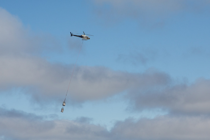 Moosonee airport: helicopter and sling headed for Moose Factory during breakup season.