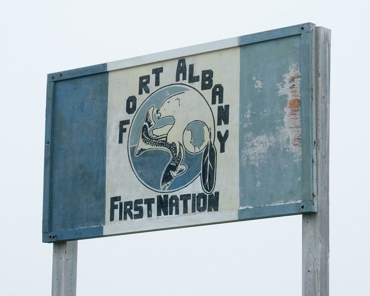 Fort Albany First Nation sign on Sinclair Island on a foggy morning.