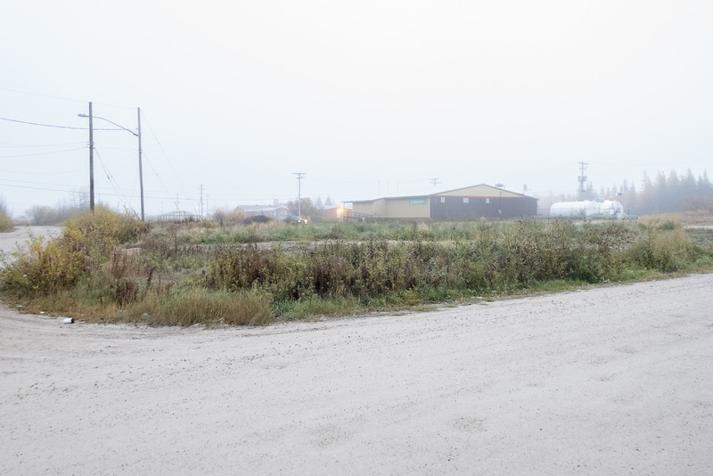 Fog, looking across site of former Roman Catholic Mission in Fort Albany towards old Northern Store and nurses' residence.