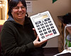 Evelyn Hookimaw with calculator used to doing month end reports.