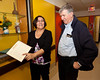 James Bay General Hospital Attawapiskat Wing Director Cecile Rose showing guest book from opening to CEO Eric Sparks.