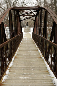 Pedestrian iron truss bridge over Spy Run Creek