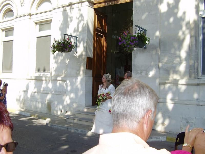 André and Muriel wait outside La Mairie.