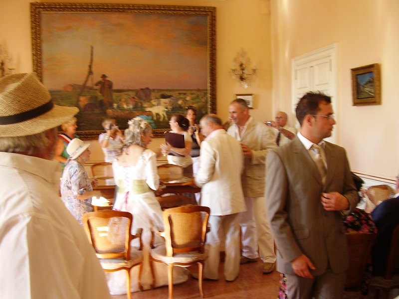 After the ceremony, people gather round the newlyweds.