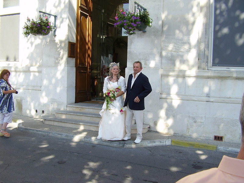 André and Muriel wait outside La Mairie. André will soon escort his sister inside.