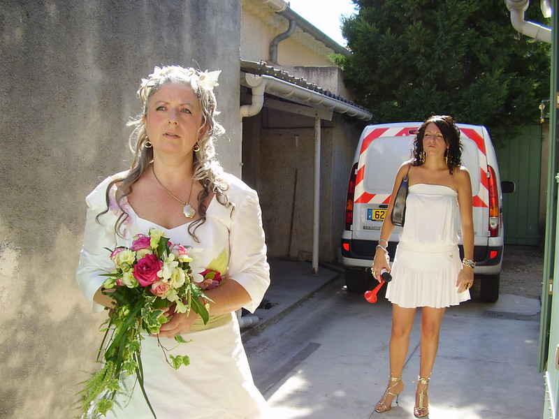 Muriel, looking lovely in her wedding dress from Marseille, and Lysiane. (Note the air horn in Lysiane's hand.)