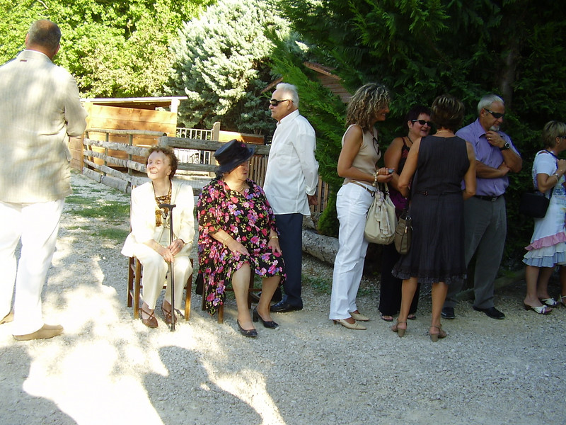 The guests line the driveway at La Table Paysanne, preparing to greet the newlyweds with a shower of rice.