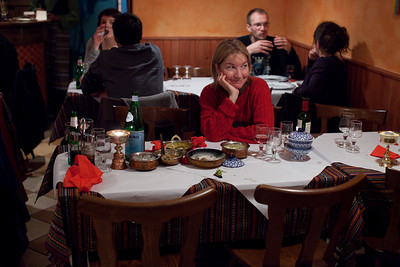 Jennifer waits for the check at Dolmas Tibetan resturant in Rennes.