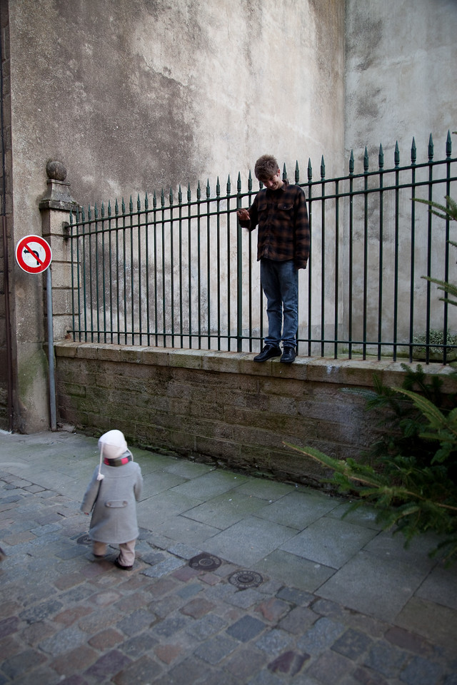 Henry is always climbing things. This toddler in Dinan was very impressed.