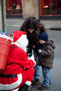 I saw a lot of street Santas handing out candy. Sure beats waiting in line at a mall.
