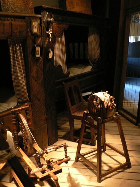 Recreated interior, with spinning wheel and lace making