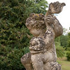 Statue at the entrance to the gardens: At the Feneuilles' chateau, Les Rochers, in Blannay