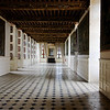 Chateau des Ducs de Brissac. The Guards Room. Note the painted wooden ceiling and the decorated window shutters.