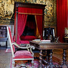 Chateau des Ducs de Brissac. The Louis XIII bedroom, with large tapestries on the walls.