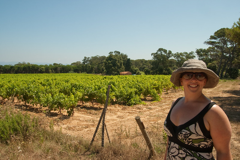 Courtney in front of a vineyard (the French keep their wine vines short! These are mature vines.): On the island of Porquerolles, off Hyères, in southern France