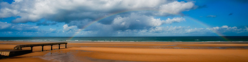 On the beach at Utah. Stunned to see this rainbow. My favorite image from our trip.