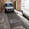 Did I mention the streets are narrow?  You can see how this van just barely fits between the curbs.  When it comes upon another delivery van (that had pulled up onto the sidewalk and the driver had exited on the passenger side to have the driver's door right up against the wall) it can't get by.  So he waited patiently.