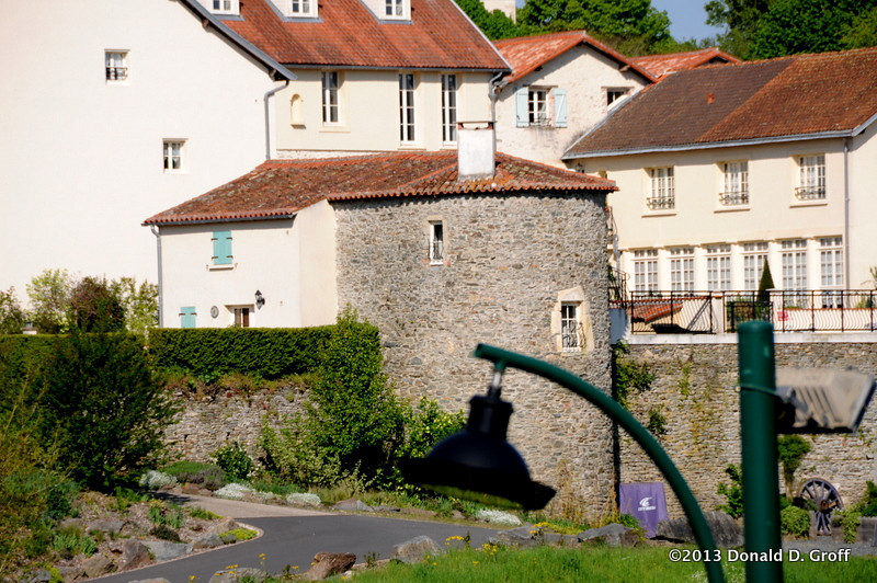 Vouvant was a walled medieval town, and some portions of the wall remain.  The blue-shuttered home attached to this roundhouse is said to be owned by author J.K. Rowling.  She was not there during our visit.