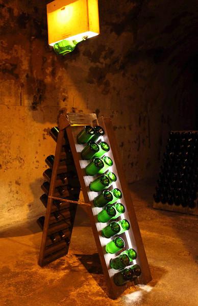 Big bottles of champagne resting in Tattinger caves