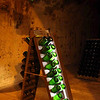 Big bottles of champagne resting in Tattinger caves