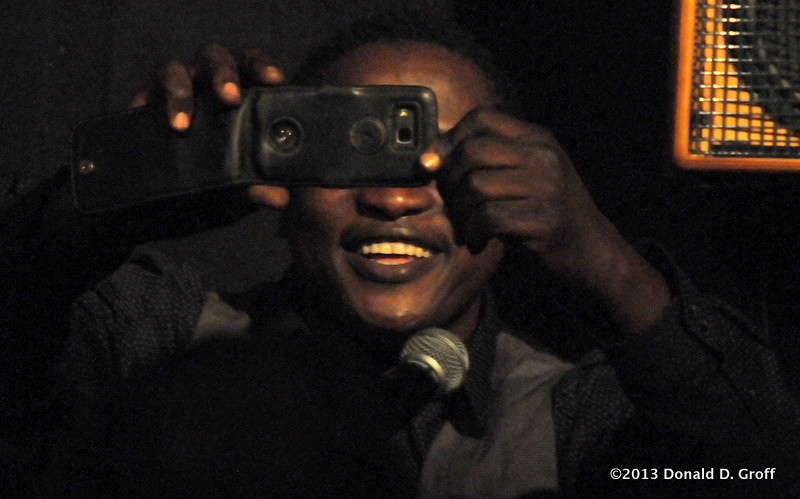 Celestin Mawndoe, from Chad, concludes his final song, singing as he shot video of the crowd in a barn outside of Vouvant.