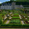 Formal Renaissance kitchen garden of the Chateau de Villandry.<br /> Vegetables and fruit trees are arranged in nine multicolored<br />  checker-board squares and enclosed by clipped hedges of yew and box.<br /> Visited and photographed on Friday, May 30, 2014