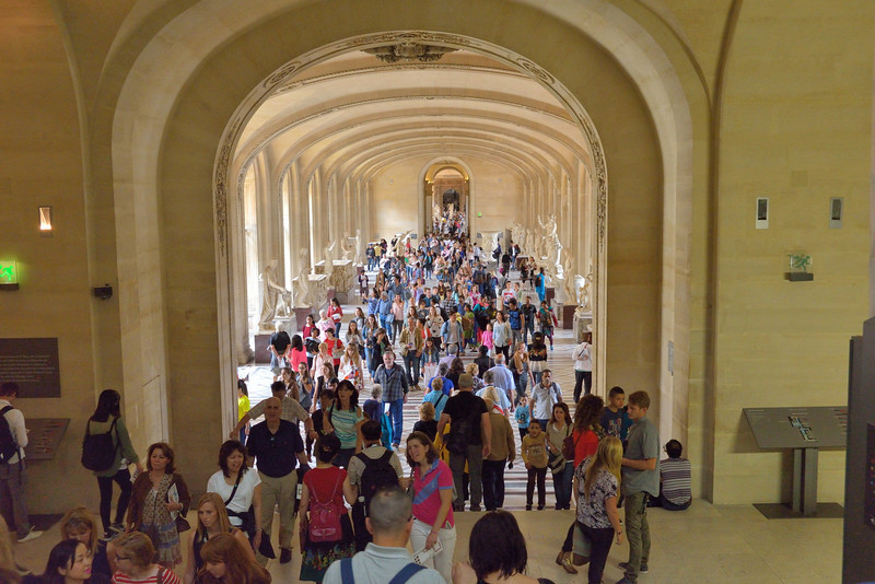 Ancient Greek and Roman statues in the Louvre Museum,<br /> with throngs of visitors,<br /> June 2, 2014