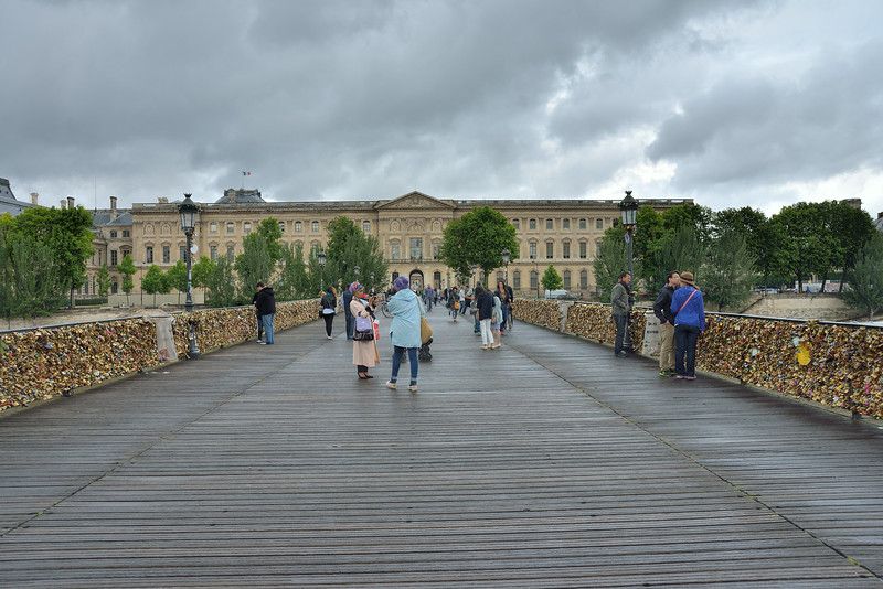 """""""Love locks"""" on the Pont des Arts footbridge in central Paris.<br /> On Sunday June 8, following our visit, a section of railing<br /> collapsed into the Seine under weight from the locks.<br /> We visited and photographed on June 4, 2014."""