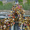"""Love locks"" on the Pont des Arts footbridge in central Paris.<br /> On Sunday June 8, following our visit, a section of railing <br /> collapsed into the Seine under weight from the locks.<br /> We visited and photographed on June 4, 2014."