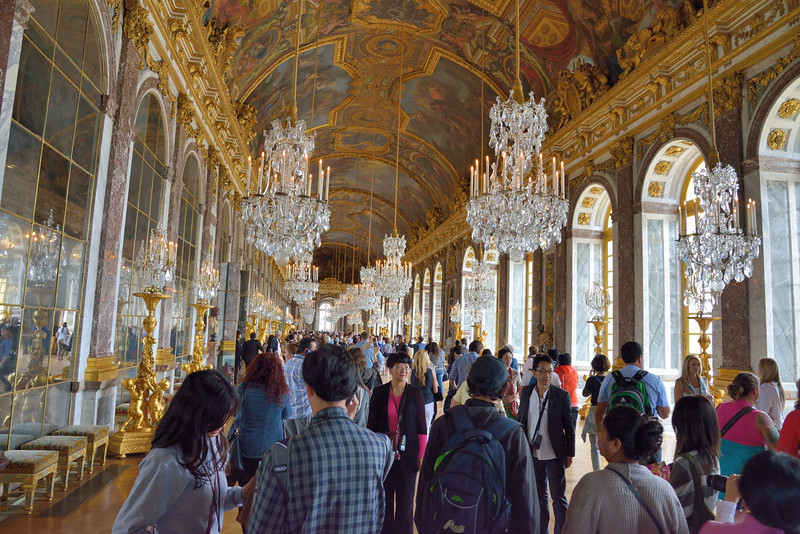 Hall of Mirrors in Versailles Palace with crowds of visitors.<br /> June 3, 2014