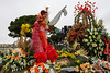 Provence-Alpes-Côte d'Azur. Nice. Nice Carnaval 2014: Bataille de Fleurs - girl on float throwing mimosas to the audience