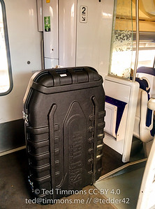 The bigass case on a local train. Nowhere to put it, so I put it in the entryway and stayed nearby for the hourlong ride.