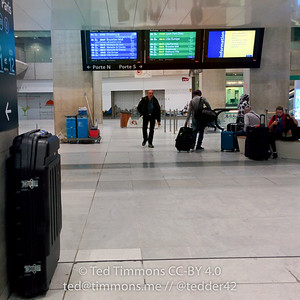 At the TGV terminal. Case is resting against a post.